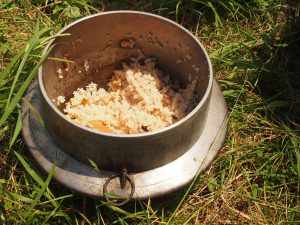 Rice cooked in an iron pot