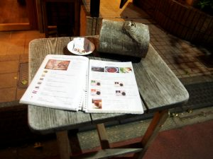 Table and Menu in front of Chikyu wo Tabisuru CAFE